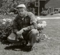 dad with grandmas peonies  1955