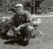 dad with grandmas peonies  1955